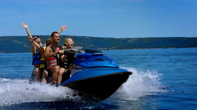 SLO MO Family Enjoying A Ride With A Jet Boat