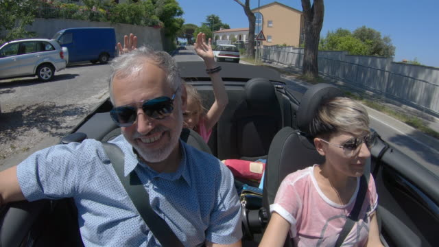 family enjoying a road trip with a convertible car - family convertible stock videos & royalty-free footage
