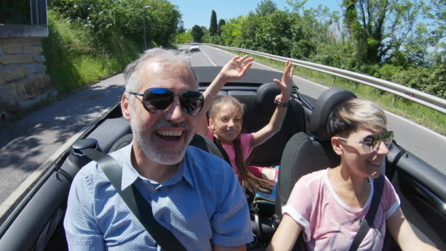 family enjoying a road trip with a convertible car - land vehicle stock videos & royalty-free footage