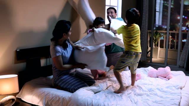 family enjoying at home, delhi, india - 枕投げ点の映像素材/bロール
