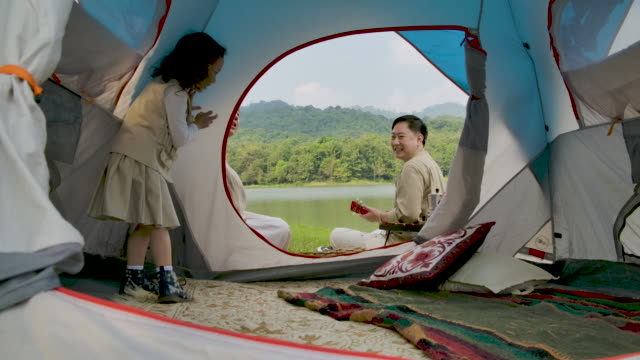 family enjoying camping holiday in countryside. - camping stock videos & royalty-free footage