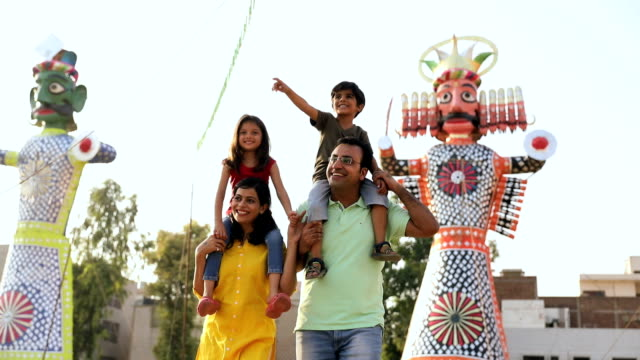 family enjoying dussehra festival, delhi, india - dashahara stock-videos und b-roll-filmmaterial