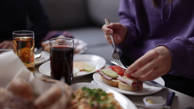 family enjoying eating breakfast together - single mother stock videos & royalty-free footage