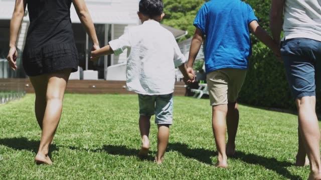 family enjoying free time on the backyard - domestic garden stock videos & royalty-free footage