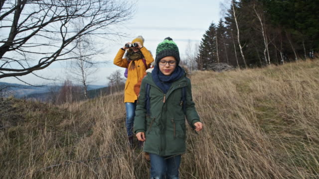 family enjoying hiking on hills - warm clothing stock videos & royalty-free footage