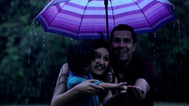 family enjoying in rain, delhi, india - umbrella stock videos and b-roll footage