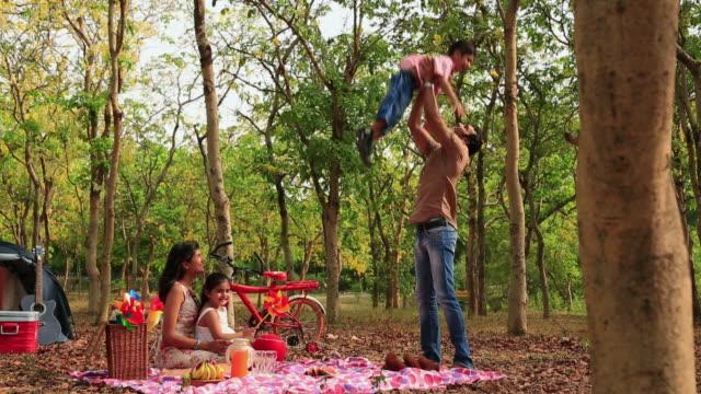 Family enjoying in the park, Delhi, India