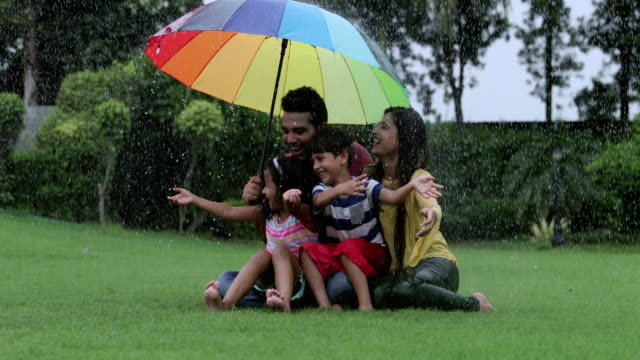Family enjoying in the rain season, Delhi, India