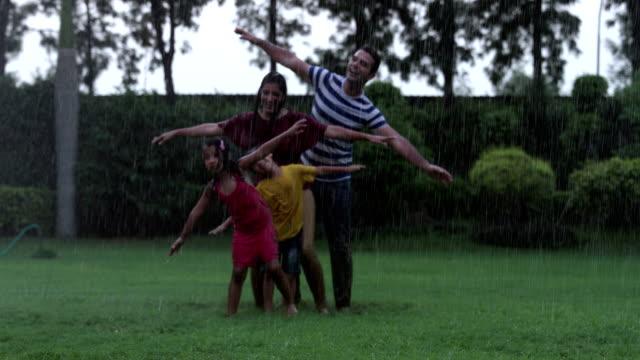 family enjoying in the rain season, delhi, india - kids in a row stock videos & royalty-free footage