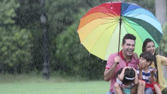 Family enjoying in the rain season, Delhi, India