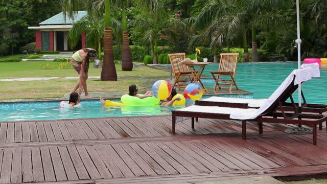 Family enjoying in the swimming pool, Delhi, India
