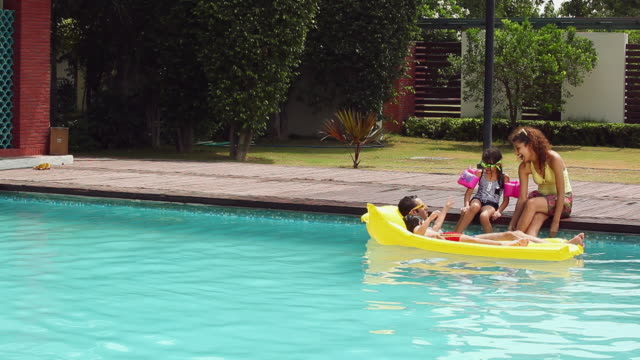 family enjoying in the swimming pool, delhi, india - sitting stock videos & royalty-free footage