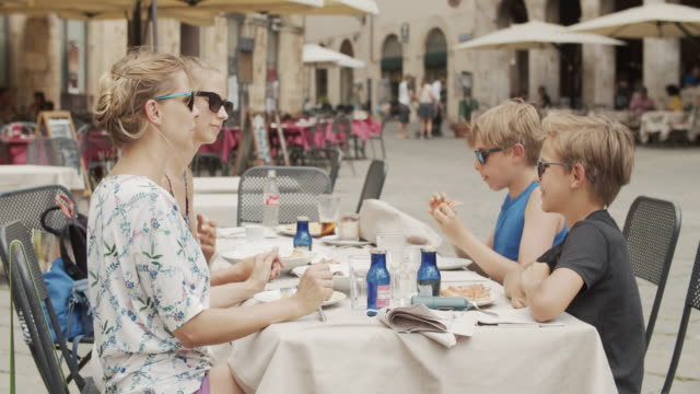 family enjoying lunch an italian restaurant - italian culture stock videos & royalty-free footage