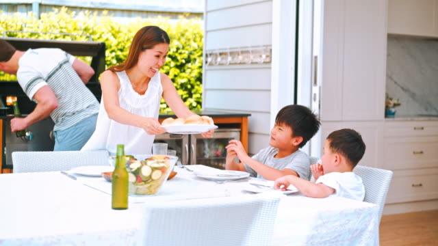 family enjoying lunch outdoors - patio stock videos & royalty-free footage