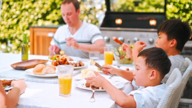 family enjoying lunch - grilled stock videos & royalty-free footage
