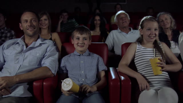 Family enjoying movie at the movie theater