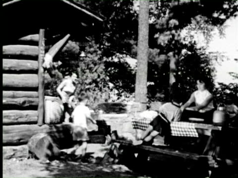 B/W POV Family enjoying outdoor camp in forest  Audio / New York