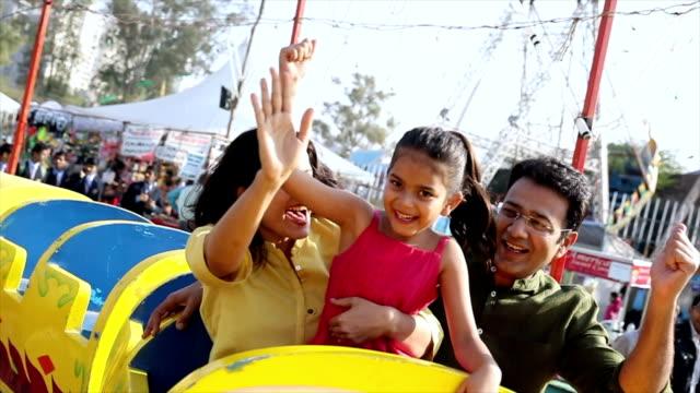 family enjoying rides at suraj kund fair, haryana, india - rollercoaster stock videos & royalty-free footage