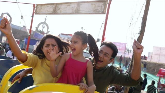 family enjoying rides at suraj kund fair, haryana, india - indian ethnicity stock videos & royalty-free footage