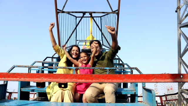 Family enjoying rides at suraj kund fair, Haryana, India