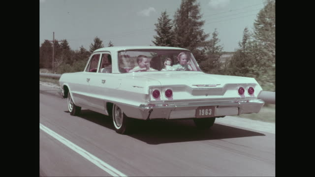 ws pov family enjoying road trip / united states - classic car stock videos and b-roll footage