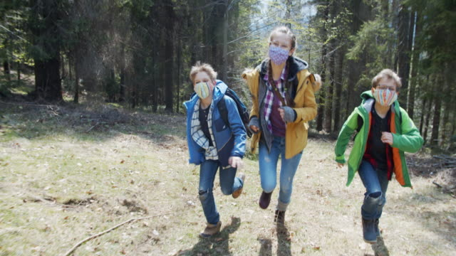 family enjoying running in forest during the covid-19 pandemic - dolly shot stock videos & royalty-free footage