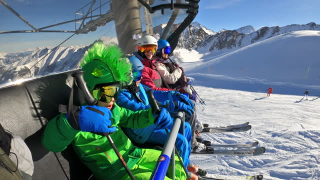 family enjoying skiing on sunny winter day - ski lift stock videos & royalty-free footage