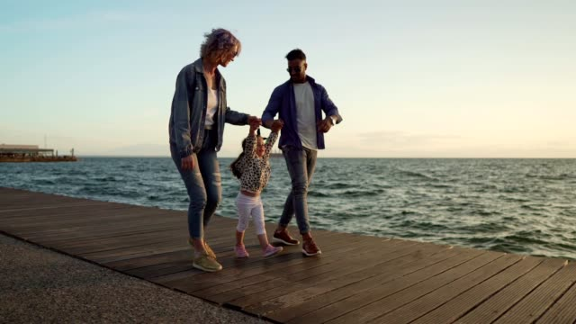 family enjoying summer day by the sea - wide shot stock videos & royalty-free footage