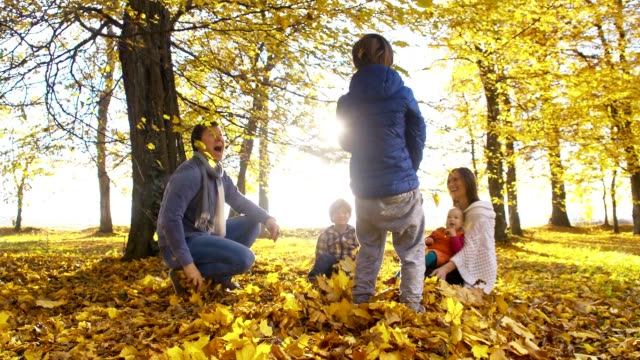 slo mo family enjoying the autumn - family with three children stock videos & royalty-free footage