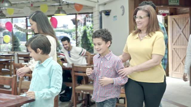 family enters a restaurant for lunch - colombian ethnicity stock videos & royalty-free footage