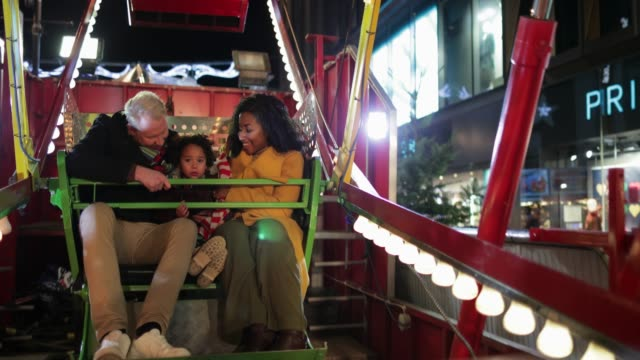 family excitement at fun fair - fairground ride stock videos & royalty-free footage