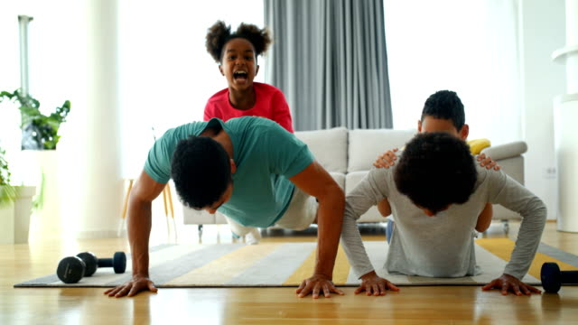 family exercising at home - sports training stock videos & royalty-free footage