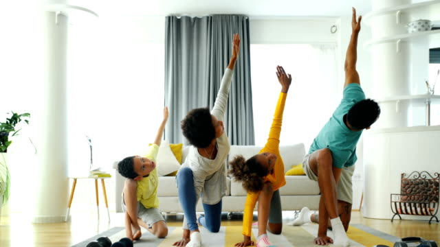 family exercising yoga at home - early morning exercise stock videos & royalty-free footage