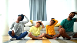 Family exercising yoga at home