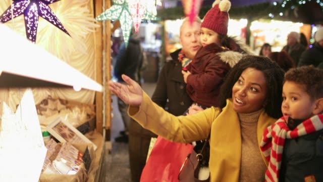family exploring festive christmas markets - december stock videos & royalty-free footage