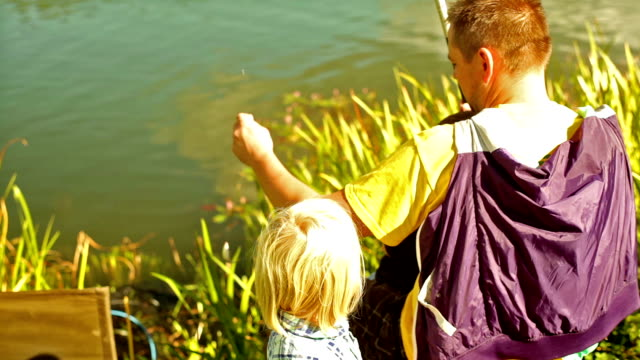 family fishing - pond stock videos & royalty-free footage