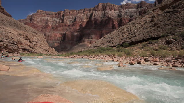 WS Family floating down rapids of Colorado river in Grand Canyon / Grand Canyon Village, Arizona, USA