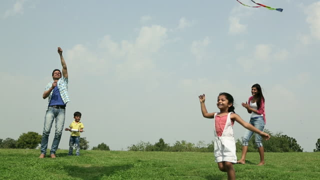 family flying kite in the park, delhi, india - kite toy stock videos and b-roll footage