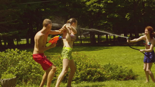 family fun at the summer's picnic: teenager girls and young man playing with water - 14 15 years stock videos and b-roll footage