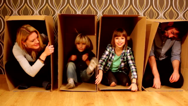 Family fun. hiding in cardboard boxes.