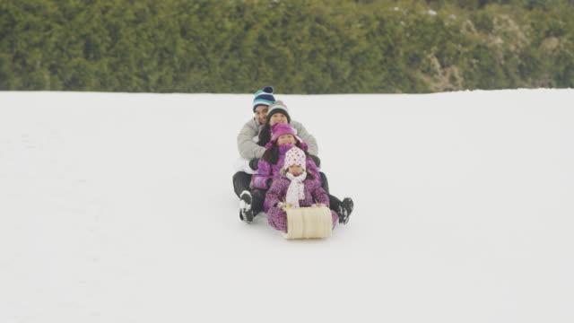 Family fun in the winter sledding on snow