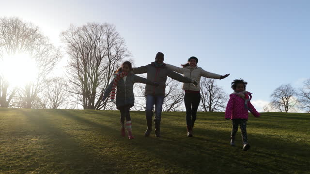 family fun running in the park - family with two children stock videos & royalty-free footage