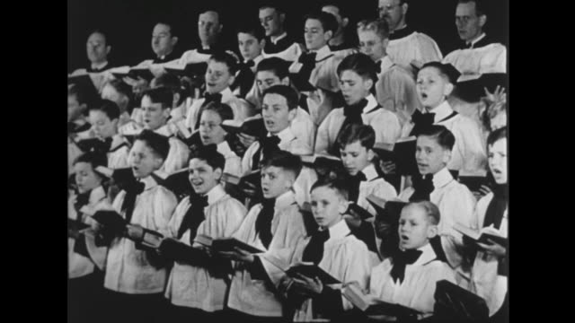 1941 family gather around piano to sing 'oh come all ye faithful' on christmas eve - choir stock videos & royalty-free footage