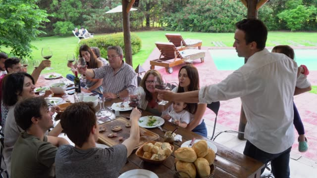 family gathered over lunch - argentinian ethnicity stock videos & royalty-free footage