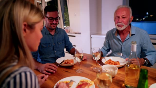 family gathering at the dinner table - adult offspring stock videos & royalty-free footage