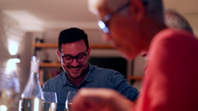 family gathering at the dinner table - evening meal stock videos & royalty-free footage