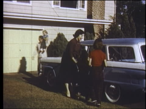 1957 family getting into blue stationwagon in driveway of suburban house / new jersey - 1957 stock videos & royalty-free footage