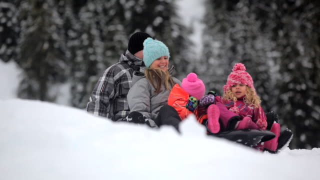 MS PAN Family getting on a toboggan  / Whistler, BC, Canada