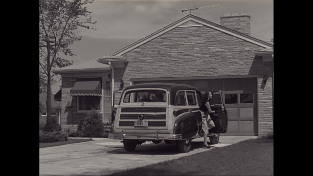 ws family getting out from car and entering into house / united states - 1950 stock videos & royalty-free footage