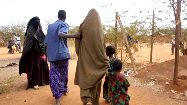 Family getting to refugee camp on July 30 2011 in Dadaab Kenya